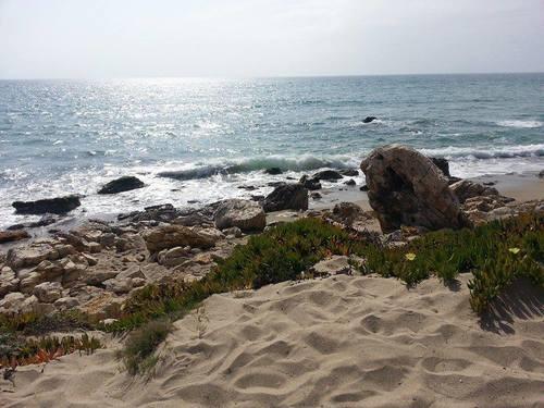 ZUMA BEACH IN MALIBU, CALIFORNIA FROM WISE OWL KIM